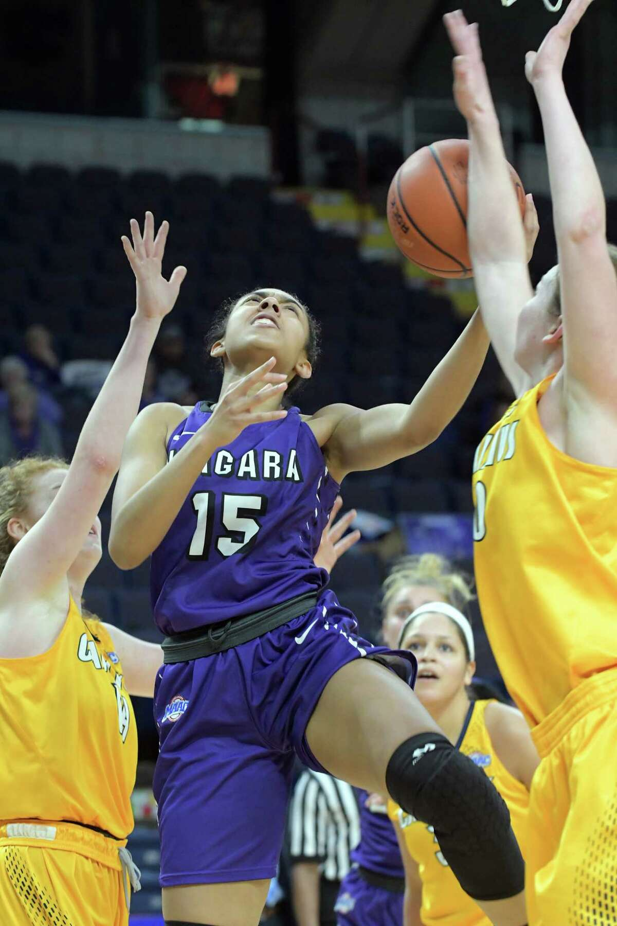 Adila Gathers of Niagara drives to the basket through Canisius players during their MAAC Basketball Tournament game at the Times Union Center on Thursday, March 2, 2017, in Albany, N.Y. (Paul Buckowski / Times Union)