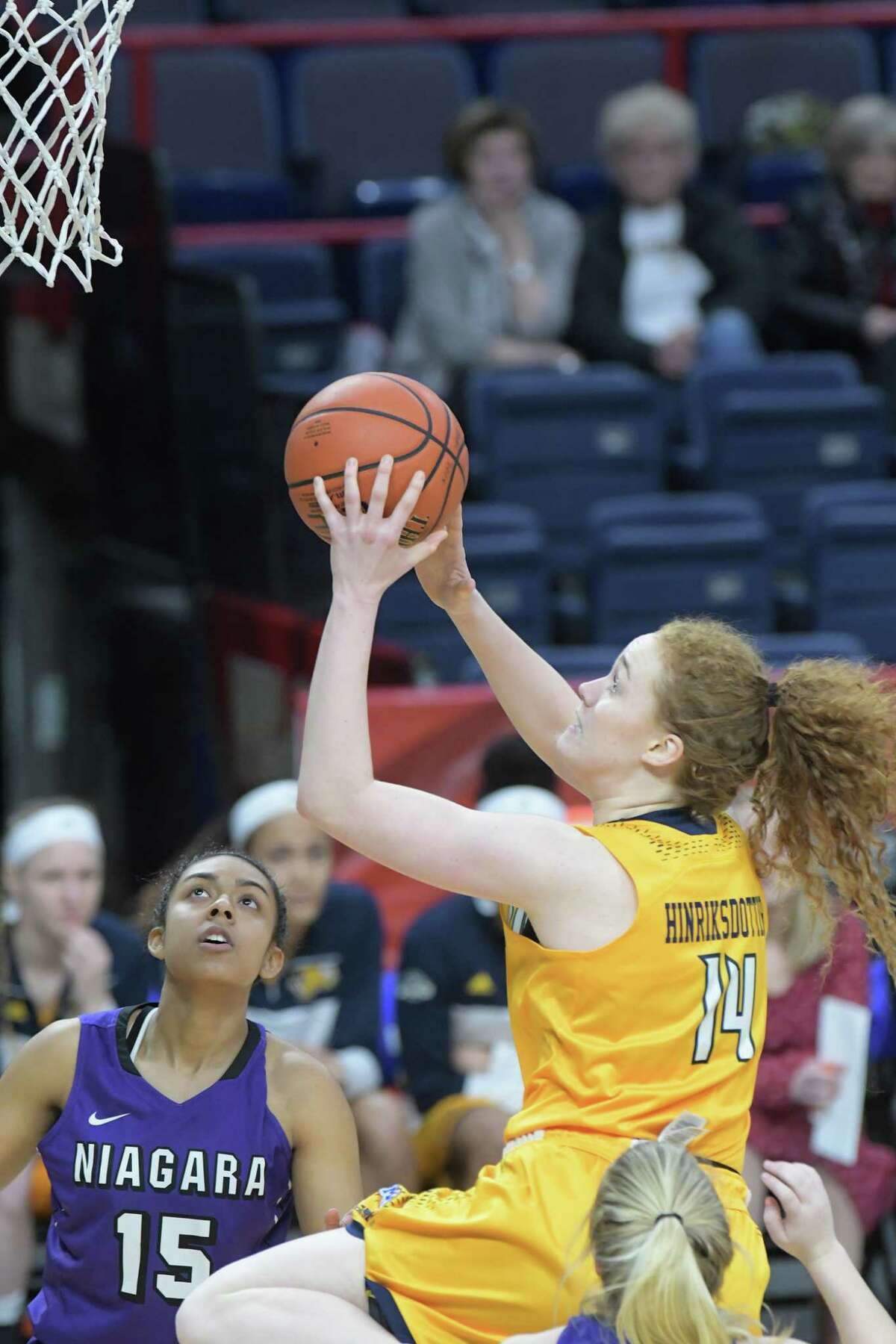 Sara Hinriksdottir of Canisius drives to the basket through Niagara players during their MAAC Basketball Tournament game at the Times Union Center on Thursday, March 2, 2017, in Albany, N.Y. (Paul Buckowski / Times Union)