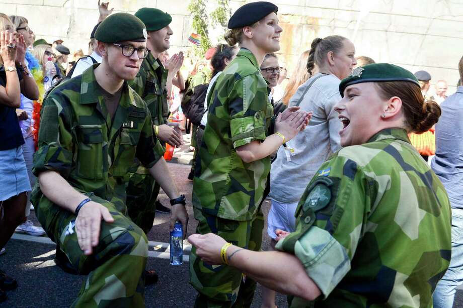 FILE - This is a Saturday Aug. 1, 2015  file photo of Swedish Army personnel as they take part in the annual gay Pride Parade in Stockholm.  Sweden's left-leaning government is reintroducing a military draft for both men and women because of what Defense Minister Peter Hultqvist calls a deteriorating security environment in Europe and around Sweden. T ?(Vilhelm Stokstad/TT , File via AP) Photo: Vilhelm Stokstad, SUB / TT NEWS AGENCY