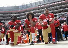 FILE - In this Oct. 2, 2016 file photo, from left, San Francisco 49ers outside linebacker Eli Harold, quarterback Colin Kaepernick and safety Eric Reid kneel during the national anthem before an NFL football game against the Dallas Cowboys in Santa Clara, Calif. Since Kaepernick announced he would not stand for the song in protest of racial discrimination against blacks in the United States, many performers are now rethinking offers to sing the national anthem. (AP Photo/Marcio Jose Sanchez, File)