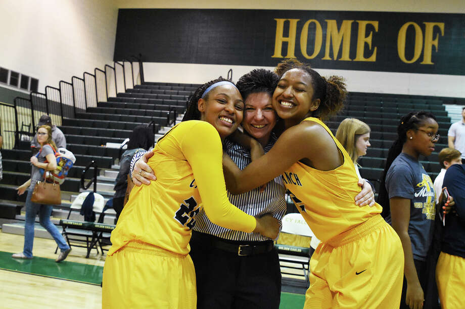 Cy Ranch coach Tresa Hornsby is happy to have Ariana Whitfield, left, and DiDi Richards, right, by her side. Photo: Tony Gaines / HCN