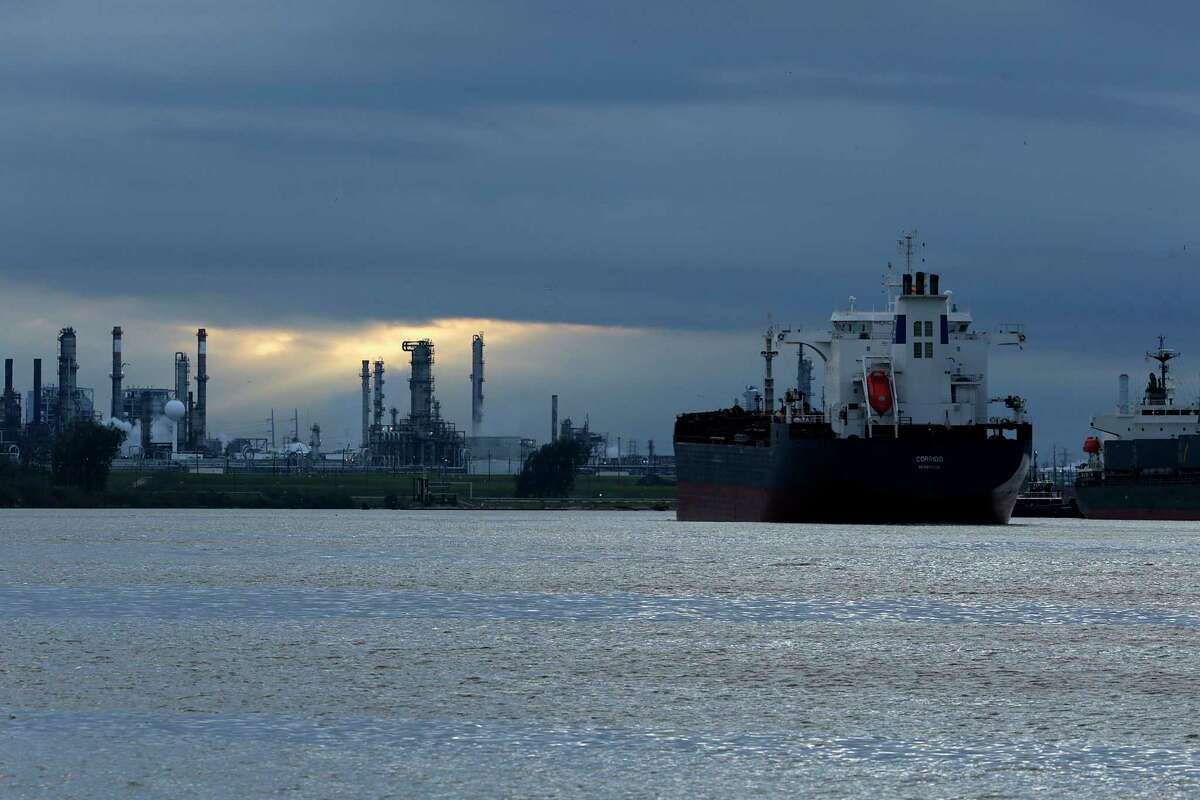 With a refinery that could be vulnerable to hackers behind it, a ship navigates through Buffalo Bayou heading to the Houston Ship Channel earlier this year.