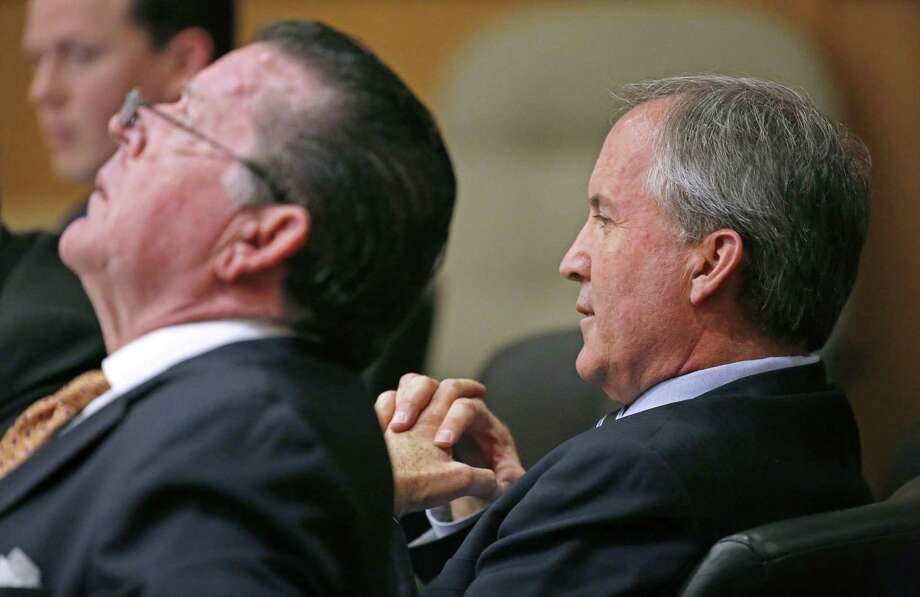 Texas Attorney General Ken Paxton, right, and his attorney Dan Cogdell sit at the defense table during his pretrial hearing ahead of his trial on felony charges that he defrauded investors before taking office, at Collin County Courthouse in McKinney, Texas, Thursday, Feb. 16, 2017. (Jae S. Lee /The Dallas Morning News via AP, Pool) Photo: Jae S. Lee, POOL / Associated Press / The Dallas Morning News
