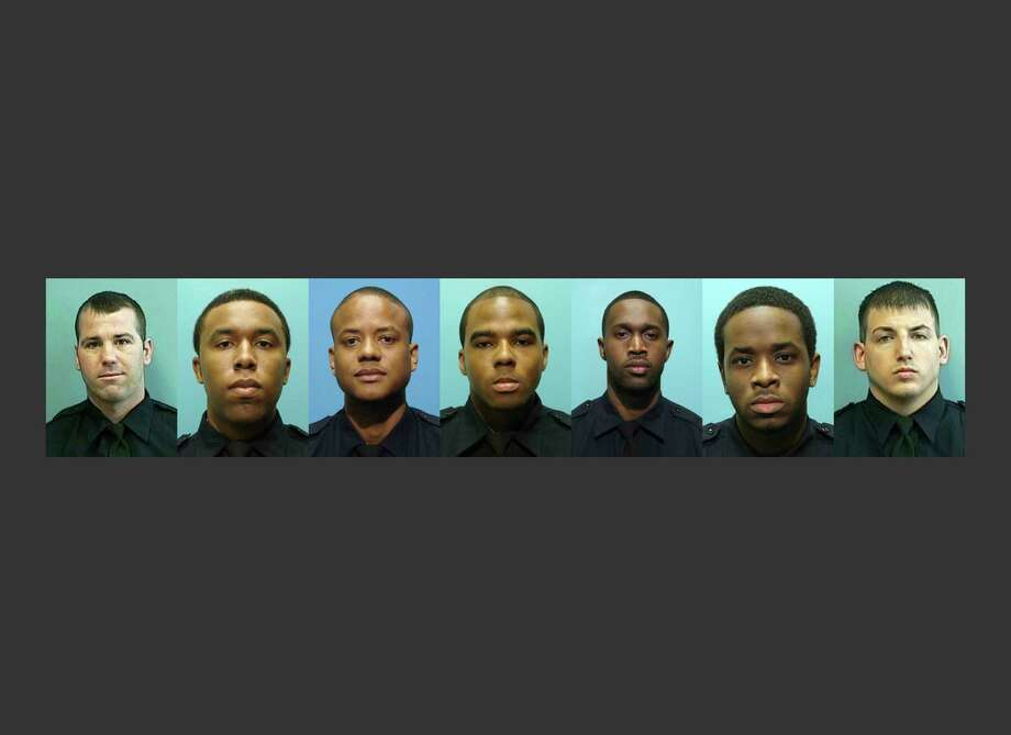 RETRANSMITTED FOR IMAGE SIZE - These undated photos provided by the Baltimore Police Department show, from left, Daniel Hersl, Evodio Hendrix, Jemell Rayam, Marcus Taylor, Maurice Ward, Momodu Gando and Wayne Jenkins, the seven police officers who are facing charges of robbery, extortion and overtime fraud, and are accused of stealing money and drugs from victims, some of whom had not committed crimes. (Baltimore Police Department via AP) Photo: HOGP / Baltimore Police Department