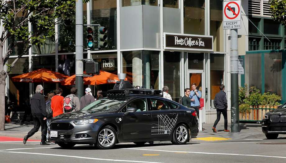 An Uber self-driving car at the corner of 3rd and Mission Streets in San Francisco. The California Public Utilities Commission has proposed regulations for robot-taxi tests within the state. Photo: Michael Macor / The Chronicle