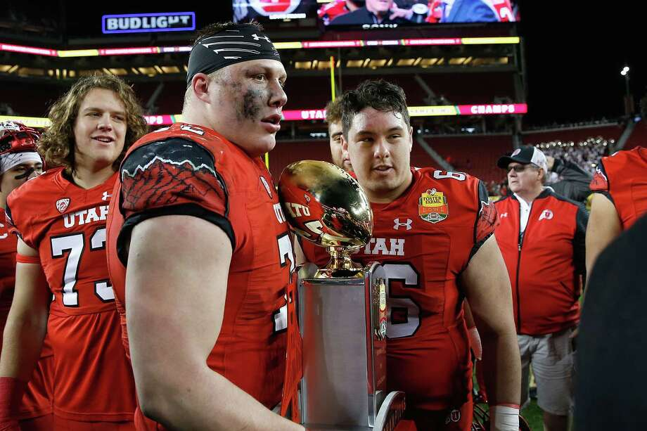 SANTA CLARA, CA - DECEMBER 28: Garett Bolle #72 and Kyle Lanterman #66 of the Utah Utes with the trophy after a win against the Indiana Hoosiers in the Foster Farms Bowl game at Levi's Stadium on December 28, 2016 in Santa Clara, California. (Photo by Lachlan Cunningham/Getty Images) Photo: Lachlan Cunningham, Stringer / 2016 Getty Images