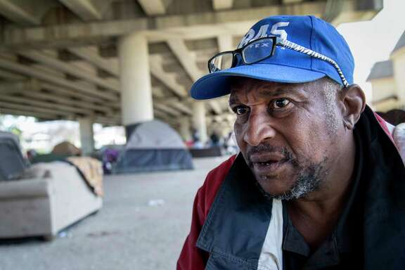 """The system just don't work for us, "" said James Davis, who has been living in a homeless camp."
