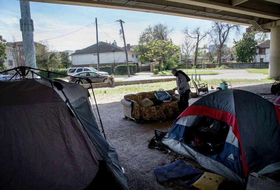 "A man who calls himself ""Mr. Wheeler Station"" lives under a U.S. 59 overpass near downtown. Photo: Jon Shapley, Staff / © 2017  Houston Chronicle"