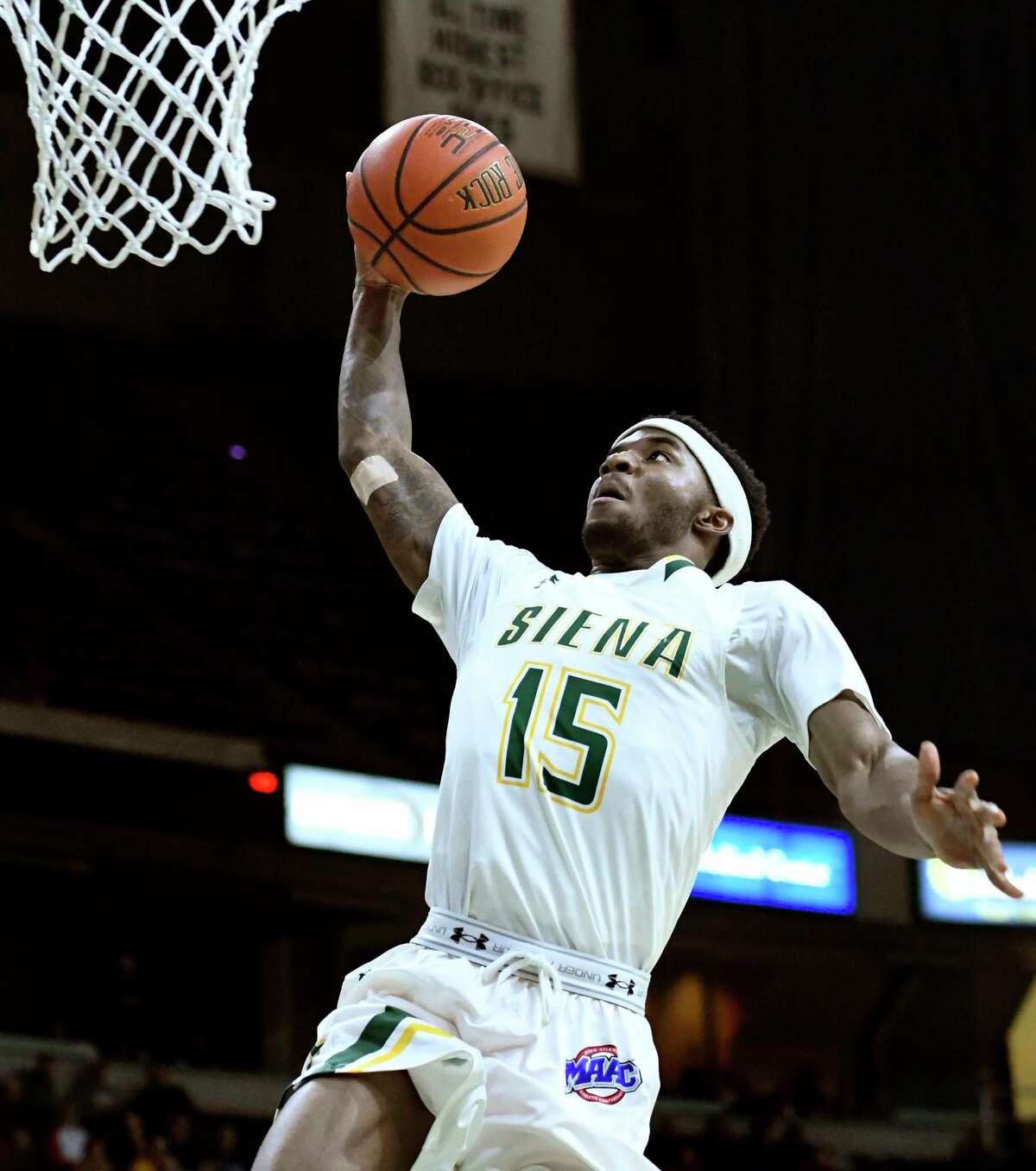 Siena's Nico Clareth dunks the ball on a breakaway during their basketball game against Vermont on Thursday, Dec. 29, 2016, at Times Union Center in Albany, N.Y. (Cindy Schultz / Times Union)