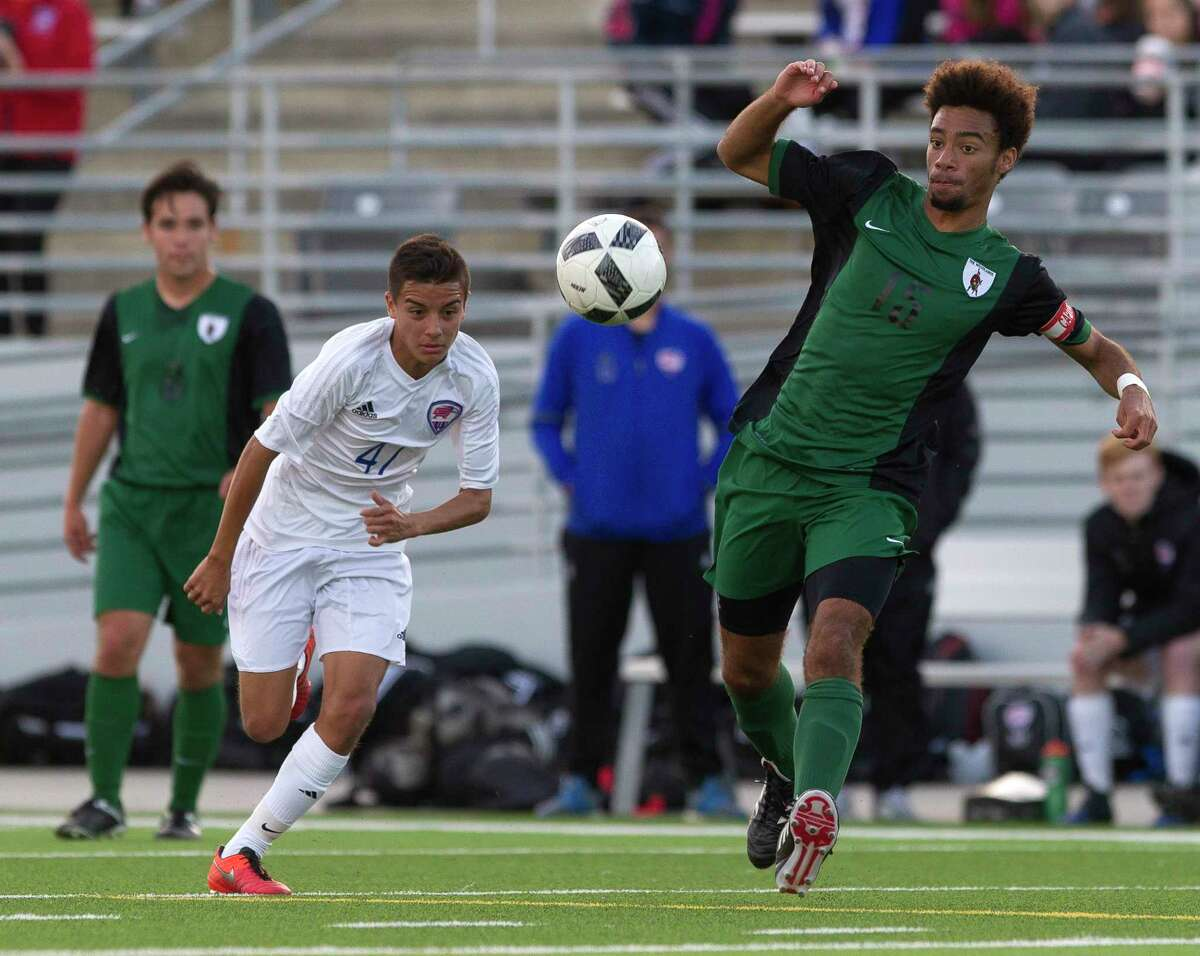 The Woodlands midfielder Wesley Mitchell (15) looks to control the ball as Oak Ridge midfielder Angel Alvarez (47) gives chase during the first period of a District 12-6A high school boys soccer match at Woodforest Bank Stadium Thursday, March 2, 2017, in Conroe. The Woodlands defeated Oak Ridge 1-0.