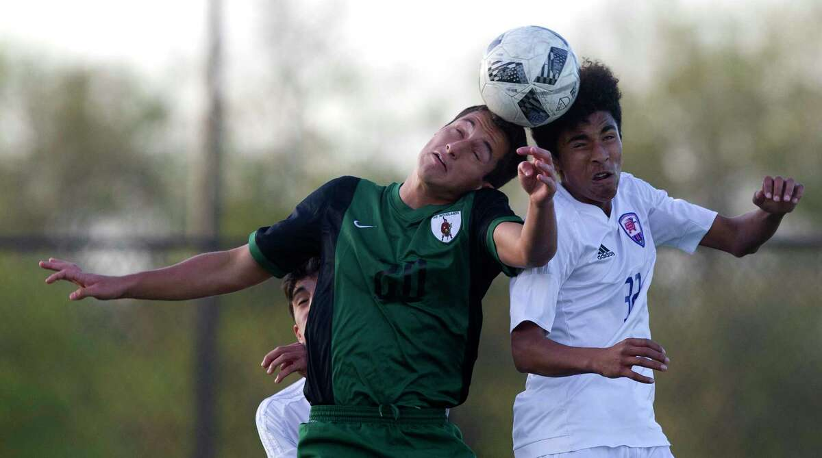 The Woodlands forward Inaki Gonzalez (20) goes for a header against Oak Ridge defenseman Alex Gomez (32) during the first period of a District 12-6A high school boys soccer match at Woodforest Bank Stadium Thursday, March 2, 2017, in Conroe. The Woodlands defeated Oak Ridge 1-0.