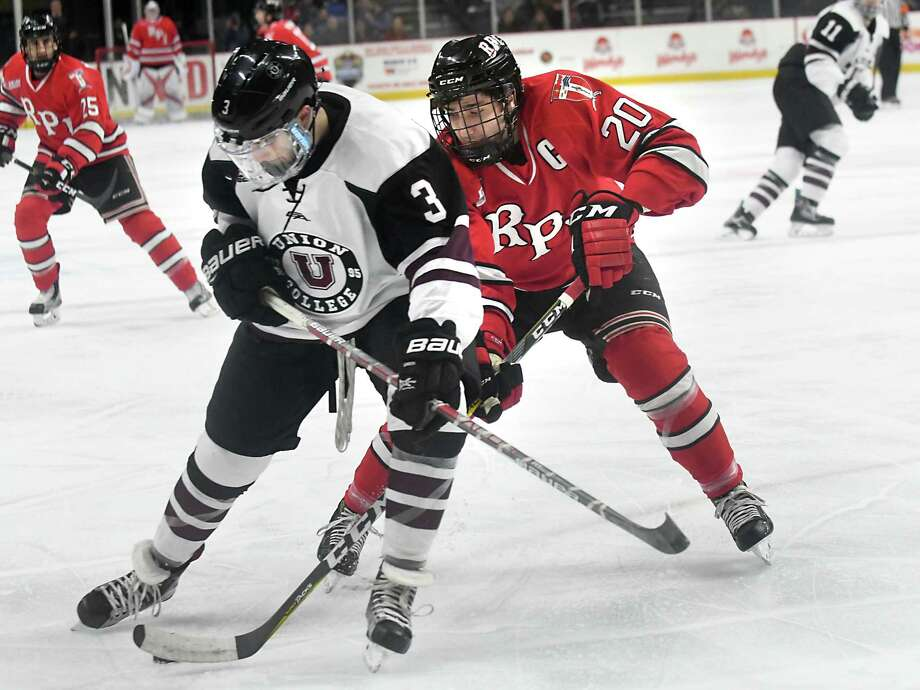 Union's Vas Kolias, left, battles with RPI's  JimmyDevito during the Mayor's cup hockey game at the Times Union Center on Thursday, Jan. 19, 2017 in Albany, N.Y. (Lori Van Buren / Times Union) Photo: Lori Van Buren / 20039466A
