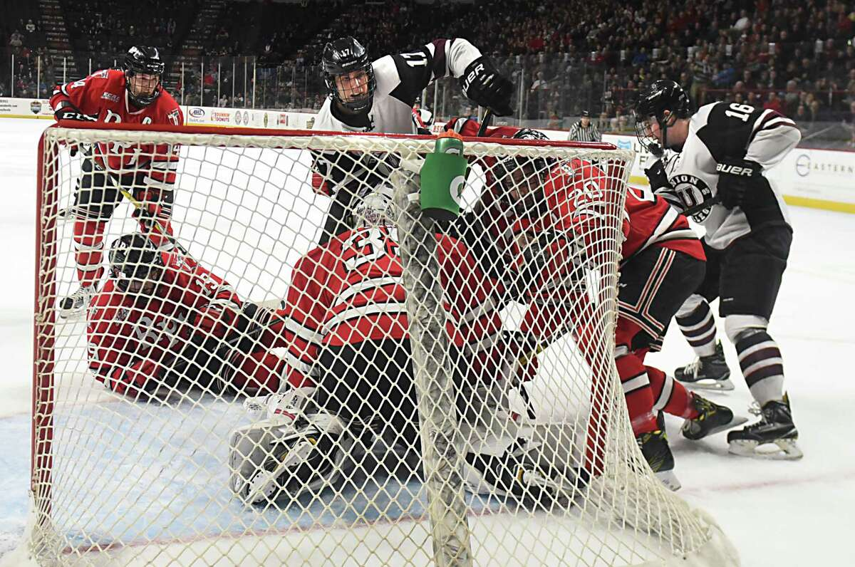 Union's Cole Maier, center top, scores the winning goal past RPI goalie Chase Perry in overtime during the Mayor's cup hockey game at the Times Union Center on Thursday, Jan. 19, 2017 in Albany, N.Y. The Engineers won 3-2. (Lori Van Buren / Times Union)