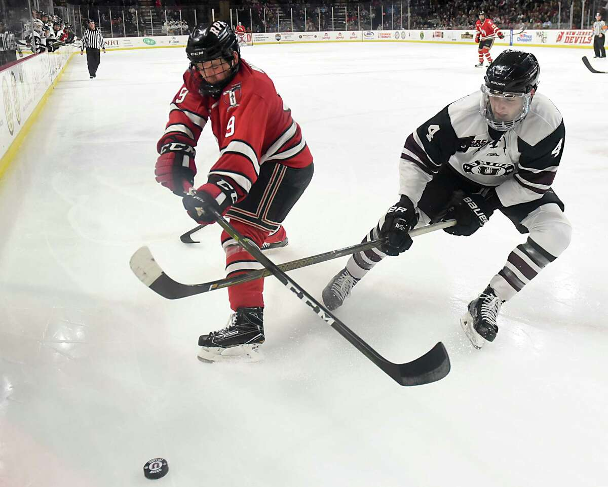 RPI's Meirs Moore battles with Union's Nick DeSimone during the Mayor's cup hockey game at the Times Union Center on Thursday, Jan. 19, 2017 in Albany, N.Y. (Lori Van Buren / Times Union)