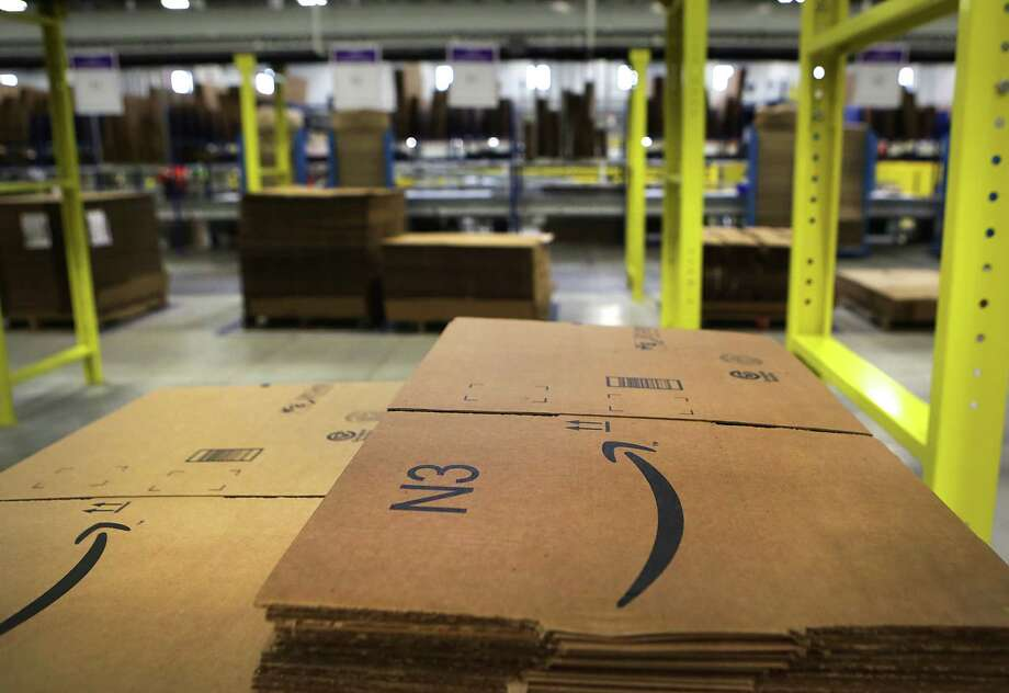 Amazon, which operates this fulfillment center in Schertz, also runs a large  and profitable cloud computing platform that such sites as Airbnb, Netflix  and Reddit use.   Photo: Bob Owen, Staff / © 2015 San Antonio Express-News