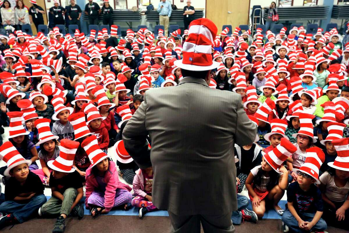 Noel Candelaria, president of the Texas State Teachers Association, talks Thursday, March 2, 2017 at Hidden Cove Elementary wearing Cat in the Hat hat during a Read Across America celebration for K-3rd graders at the school. Read Across America, a National Education Association-organized event is held on Dr. Seuss's birthday, March 2nd, every year.