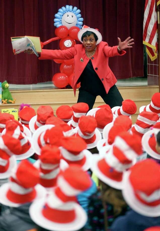 Becky Pringle, vice president of the National Education Association, reads Dr. Seuss's Green Eggs and Ham Thursday, March 2, 2017 at Hidden Cove Elementary during a Read Across America celebration for K-3rd graders at the school. Read Across America, a National Education Association-organized event is held on Dr. Seuss's birthday, March 2nd, every year. Photo: William Luther, San Antonio Express-News / © 2017 San Antonio Express-News