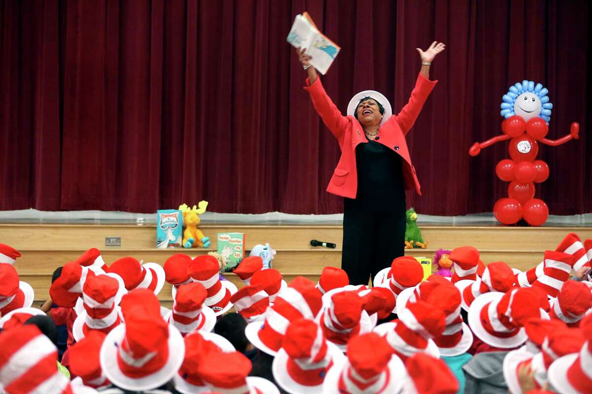 Becky Pringle, vice president of the National Education Association, reads Dr. Seuss's Green Eggs and Ham Thursday, March 2, 2017 at Hidden Cove Elementary during a Read Across America celebration for K-3rd graders at the school. Read Across America, a National Education Association-organized event is held on Dr. Seuss's birthday, March 2nd, every year.