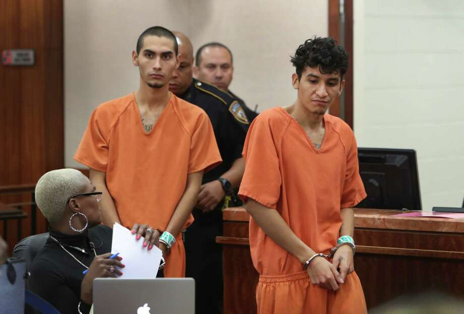 """Two known MS-13 gang members, Miguel Alvarez-Flores, 22, also known as """"Diabolico,"""" front, and Diego Hernandez-Rivera, 18, face charges in the aggravated kidnapping in one case and torture and killing of another victim in another case.  Photo: Steve Gonzales, Staff / © 2017 Houston Chronicle"""