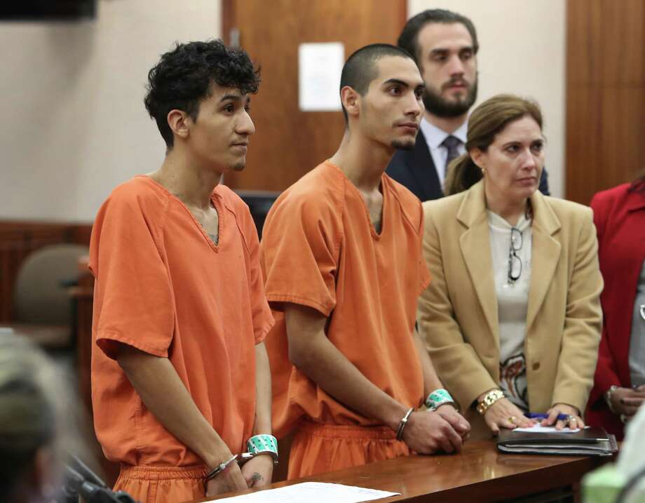 Two known MS-13 gang members, Miguel Alvarez-Flores, 22, and Diego Hernandez-Rivera, 18, are on immigration hold in lieu of $300,000 bail. Photo: Steve Gonzales, Staff / © 2017 Houston Chronicle