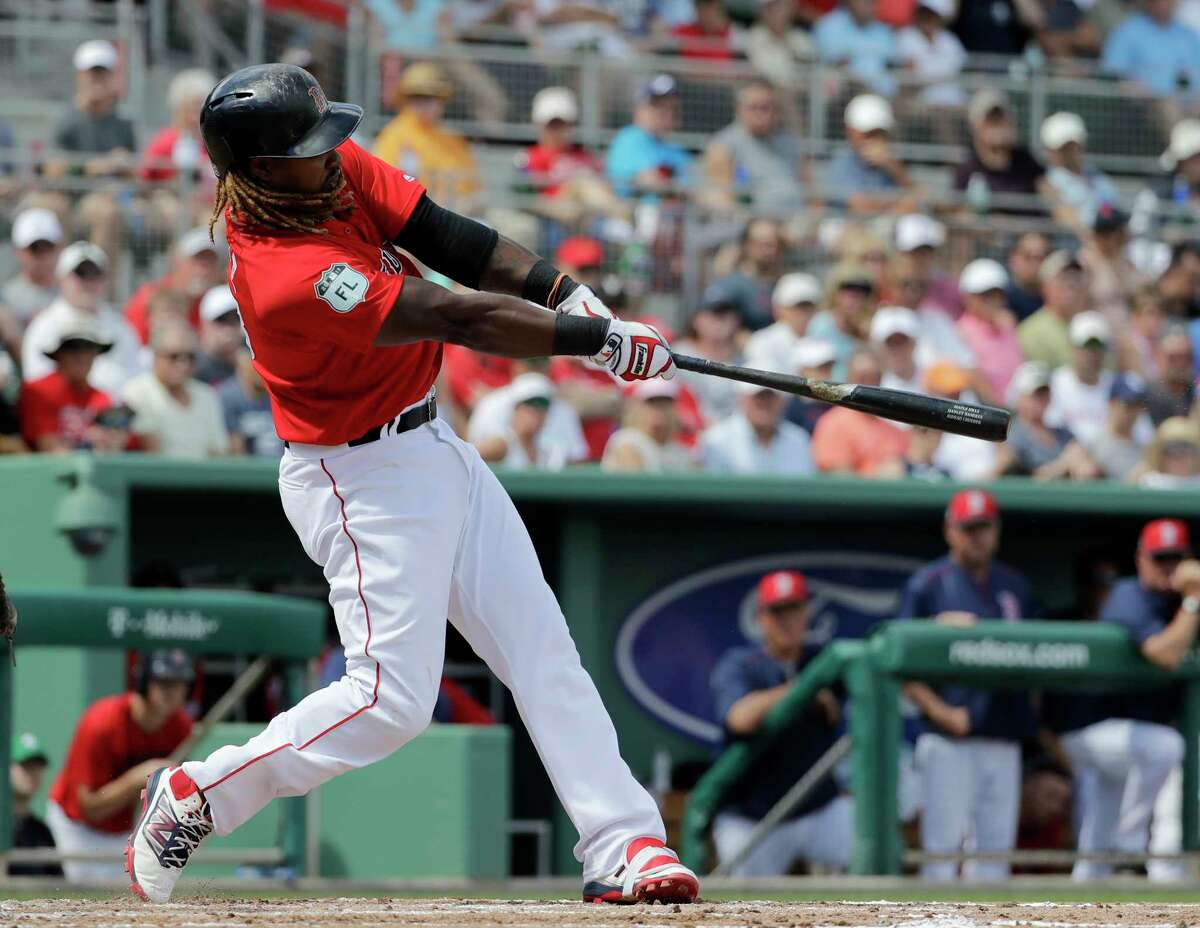 Boston Red Sox's Hanley Ramirez hits a three-run home run in the second inning of an exhibition spring training baseball game against the Tampa Bay Rays in Fort Myers, Fla., Thursday, March 2, 2017. (AP Photo/David Goldman) ORG XMIT: FLDG103