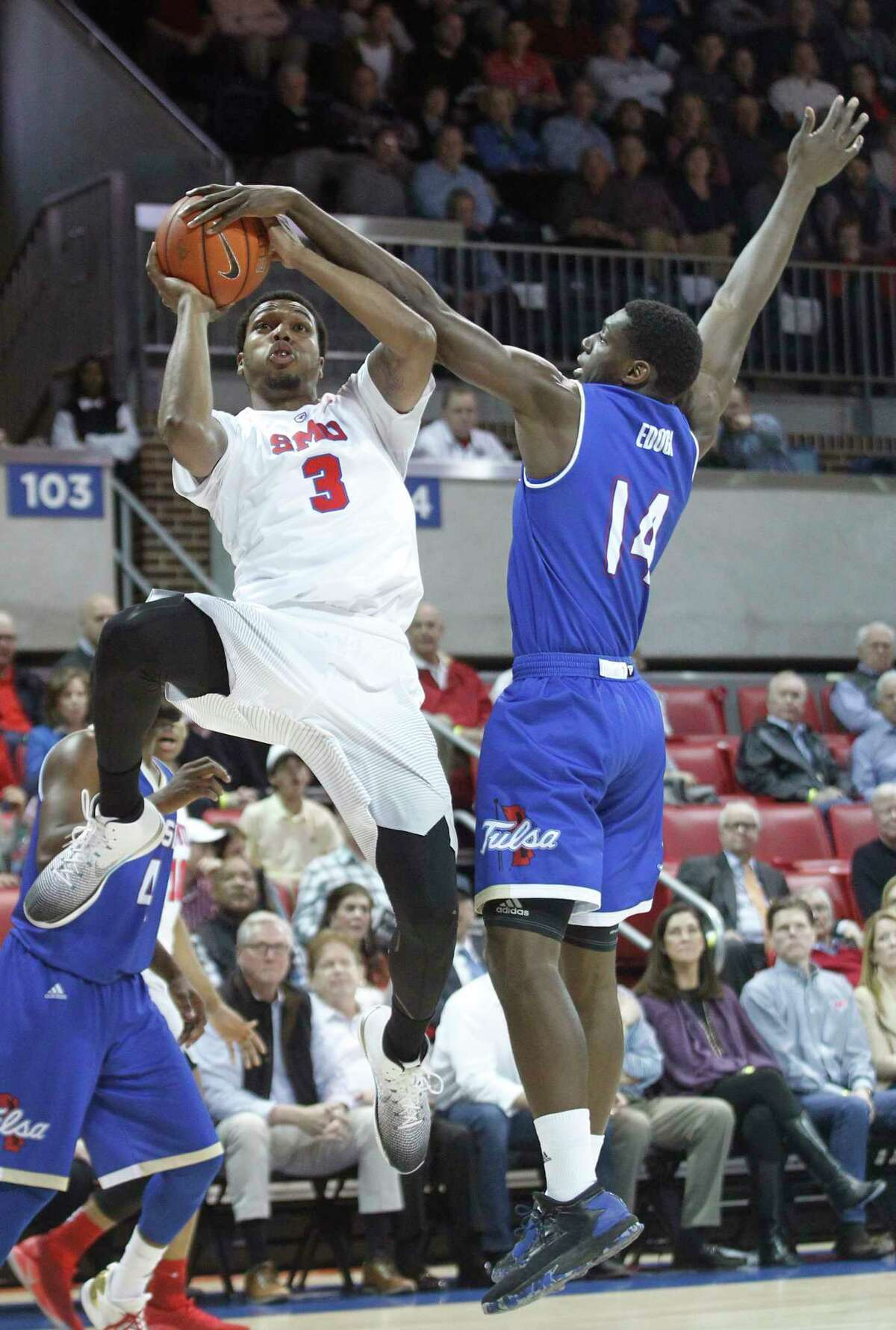 SMU guard Sterling Brown (3) is fouled by Tulsa forward Tarekeyi Edogi (14) during the first half of an NCAA college basketball game, Thursday, March 2, 2017, in Dallas.