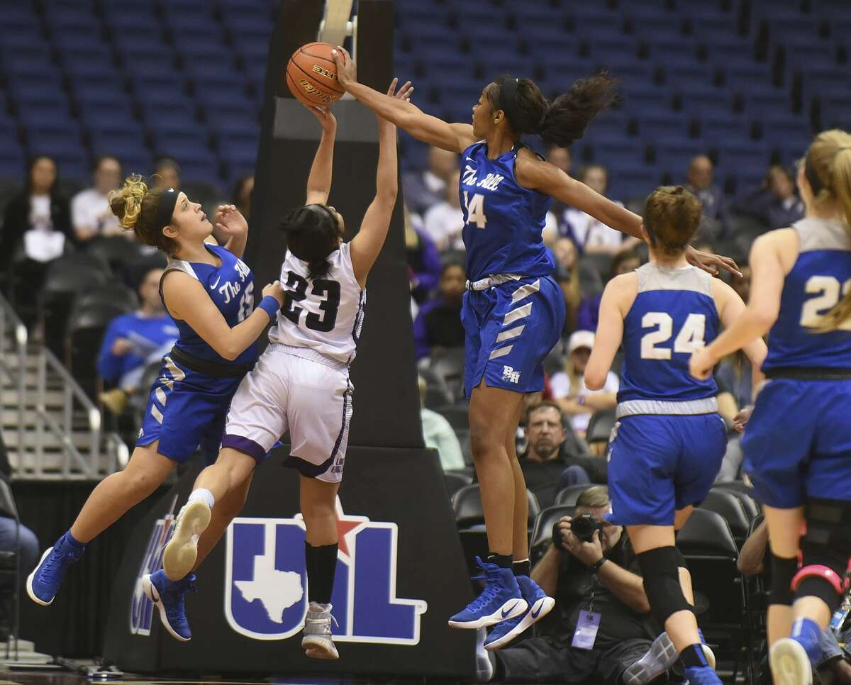 Charli Collier (14) of Mont Belvieu Barbers Hill blocks a shot attempt by Angel Hayden (23) of Canyon during second-half Class 5A state semifinals action in the Alamodome in San Antonio on Thursday, March 2, 2017.