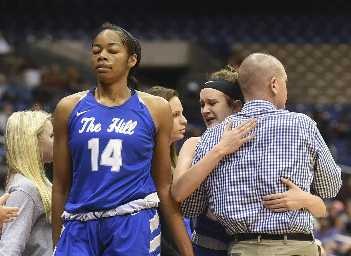 Mont Belvieu Barbers Hill's Kayla Konarik hugs coach Tri Danley as she leaves the game in the final minute with teammate Charli Collier (14) during team's loss to Canyon in the Class 5A state semifinals in the Alamodome in San Antonio on Thursday, March 2, 2017.
