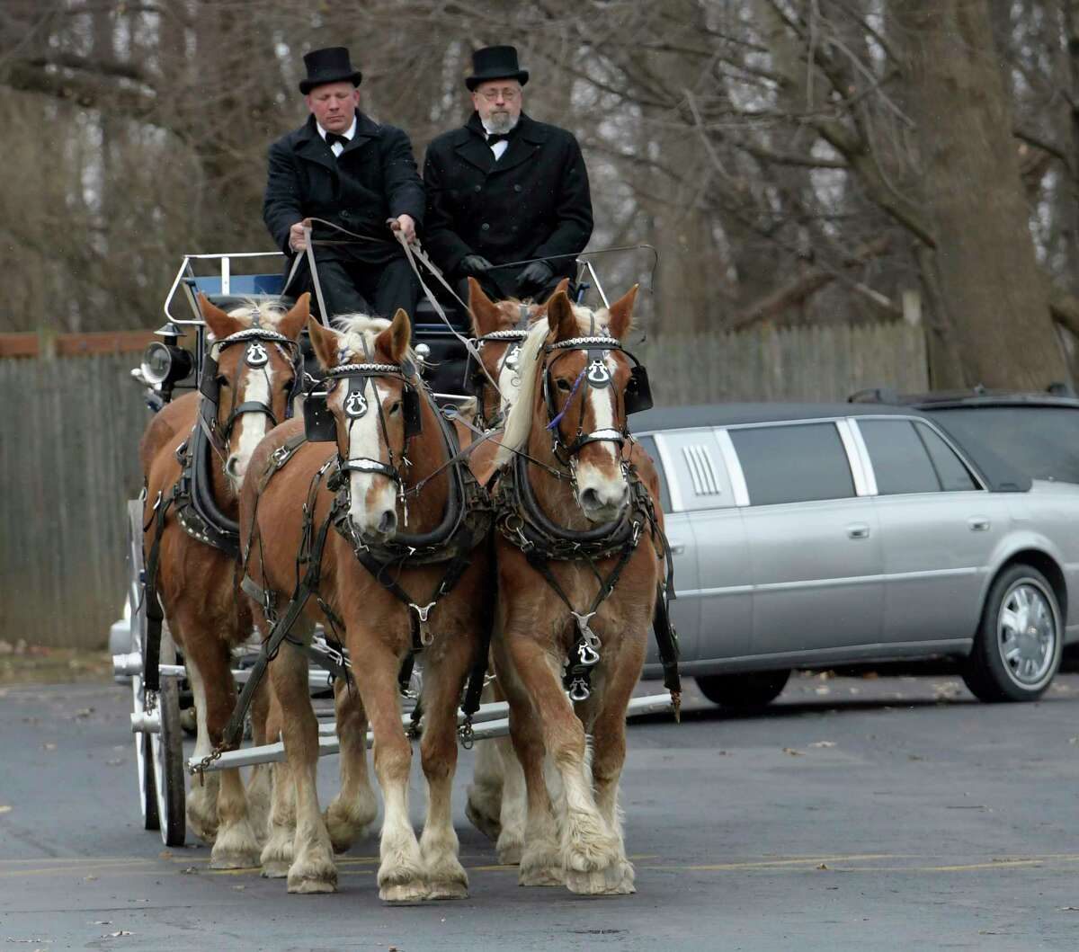 The casket carrying the remains of local businessman J. Kenneth Ray is carried to Our Lady of Victory Church on a horse drawn carriage driven by Kurt Johnson, left and Bill Clark, from the funeral home on Hoosick Street on Thursday, March 2, 2017, in North Hoosic, N.Y. (Skip Dickstein/Times Union)