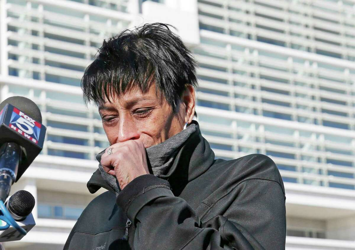 Evelyn Rodriguez, mother of Kayla Cuevas, 16, who was brutally slain in 2016 allegedly by members of the MS-13 street gang, weeps after stopping to talk members of the press gathered outside U.S. District Court in Central Islip, N.Y., Thursday, March 2, 2017. Rodriguez was reacting to news that 13 members of the MS-13 gang have been indicted in seven Long Island slayings, including the murder of 16 year-old Cuevas and 15 year-old Nisa Mickens. U.S. Attorney Robert L. Capers of the Eastern District of New York, and other law enforcement officials, including the FBI, announced the indictments Thursday at the federal court in Islip. (AP Photo/Kathy Willens) ORG XMIT: NYKW103