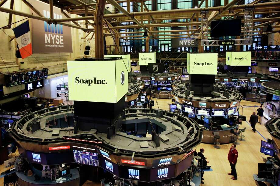The New York Stock Exchange is prepared for the IPO of Snap Inc., Thursday, March 2, 2017. The company behind the popular messaging app Snapchat is expected to start trading Thursday after a better-than-expected stock offering. (AP Photo/Mark Lennihan) Photo: Mark Lennihan, STF / Copyright 2017 The Associated Press. All rights reserved.