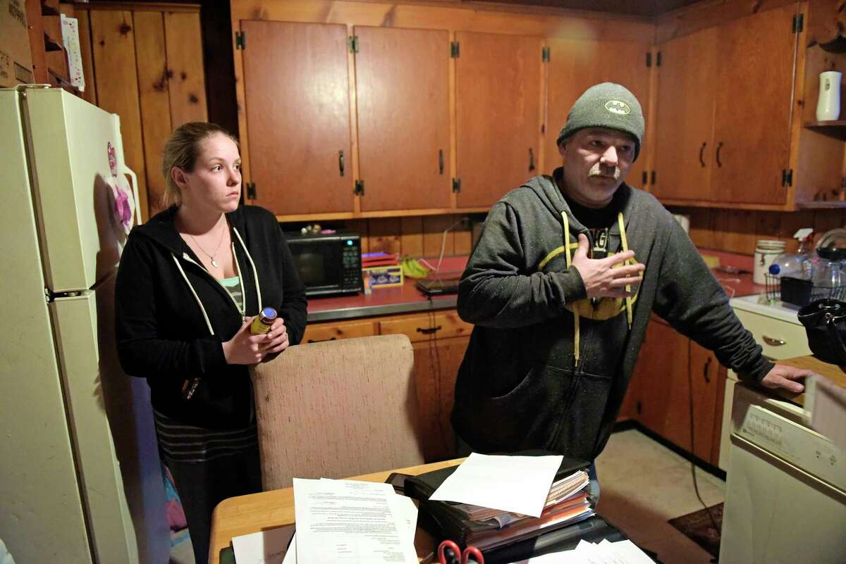 Angelica Smith, left, and her fiance, Breck Luce, talk about the problems they have been having with their landlord during an interview on Tuesday evening, Feb. 28, 2017, in Glens Falls, N.Y. (Paul Buckowski / Times Union)