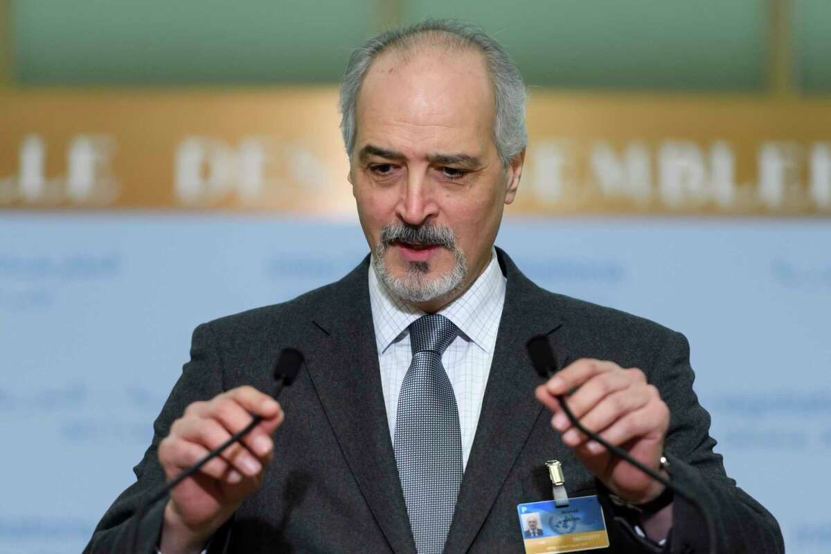 Syrian chief negotiator Bashar al-Jaafari, Ambassador of the Permanent Representative Mission of Syria to UN New York, informs to the media after the round of negotiation between the Syrian government and the UN Special Envoy of the Secretary-General for Syria Staffan de Mistura (not pictured), at the European headquarters of the United Nations in Geneva, Switzerland, Thursday, March 2, 2017. (Martial Trezzini/Keystone via AP) ORG XMIT: LON816