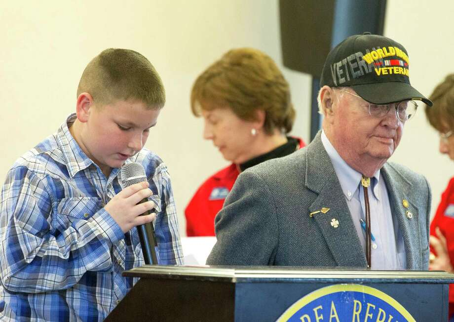 Fifth grader Braden Tedder, left, talks about local World War II veteran Charles Trotter, Sr., whom he wrote his 'My American Hero' essay about, during a Lake Conroe Area Republican Women club meeting at April Sound Country Club Thursday, March 2, 2017, in Montgomery. Photo: Jason Fochtman, Staff Photographer / © 2017 Houston Chronicle