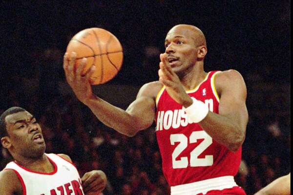 FILE -- Houston Rockets' Clyde Drexler goes to the hoop against Portland Trail Blazer guard Aaron McKie in Portland, Ore., April 7, 1995.(AP Photo/Don Ryan)