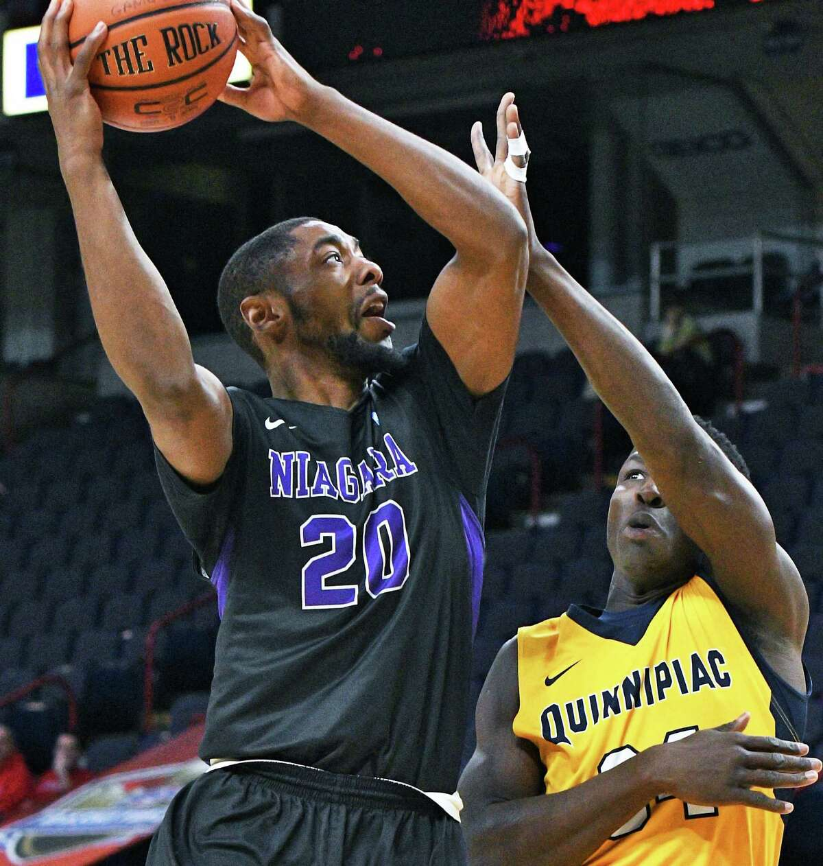 Niagara's #20 Maurice Taylor Jr., left, goes to the net as Quinnipiac's #34 Abdulai Bundu defends during their first round MACC tourney game at the Times Union Center Thursday March 2, 2017 in Albany, NY. (John Carl D'Annibale / Times Union)