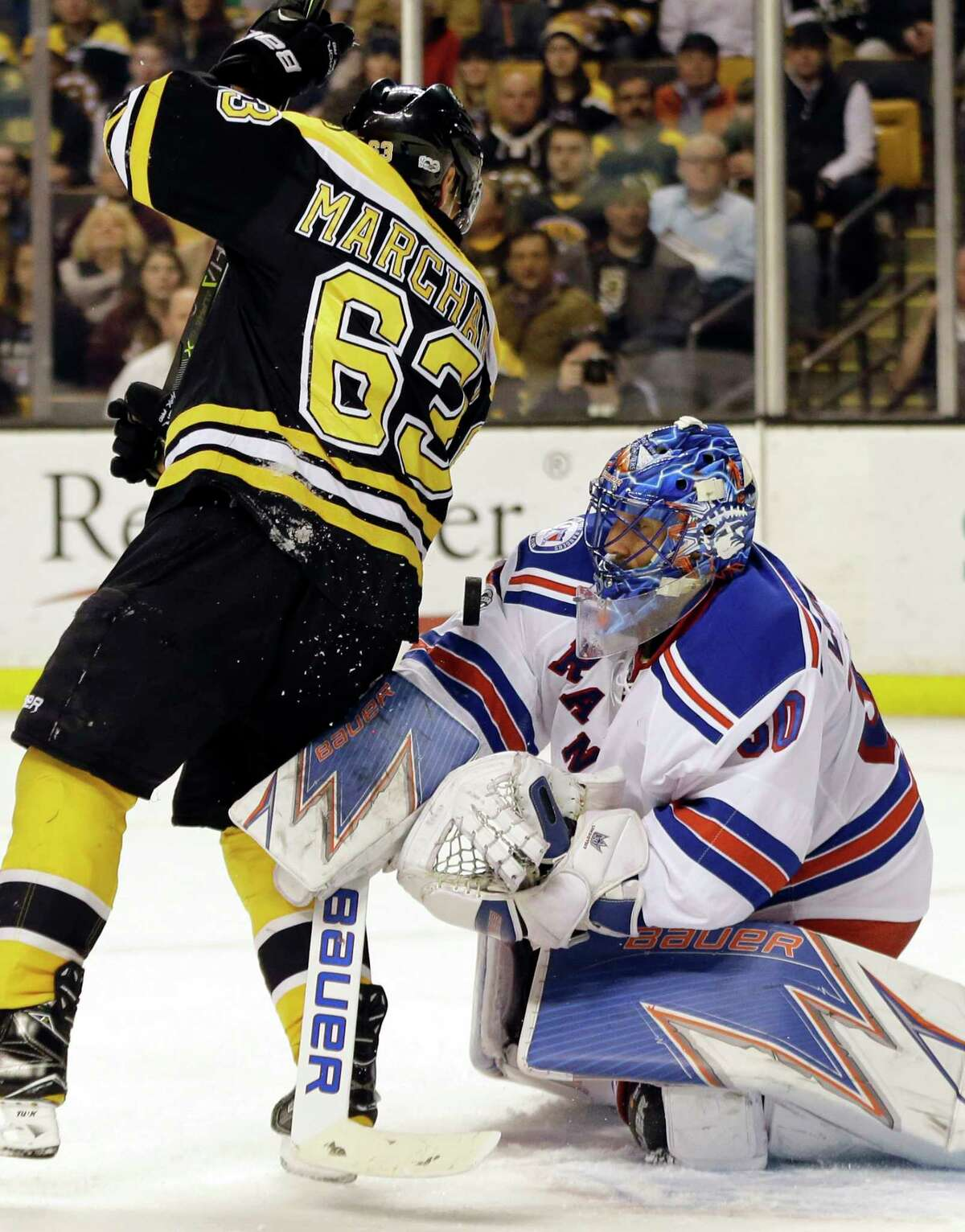 New York Rangers goalie Henrik Lundqvist (30) defends as Boston Bruins left wing Brad Marchand (63) tries to gain position in front of the net during the second period of an NHL hockey game, Thursday, March 2, 2017, in Boston. (AP Photo/Elise Amendola) ORG XMIT: MAEA104