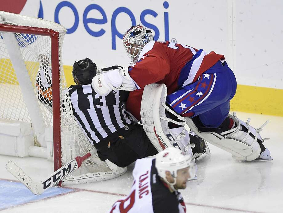 In his eighth shutout, Capitals goalie Braden Holtby's biggest test may have been provided by referee Dan O'Halloran. Photo: Nick Wass, Associated Press