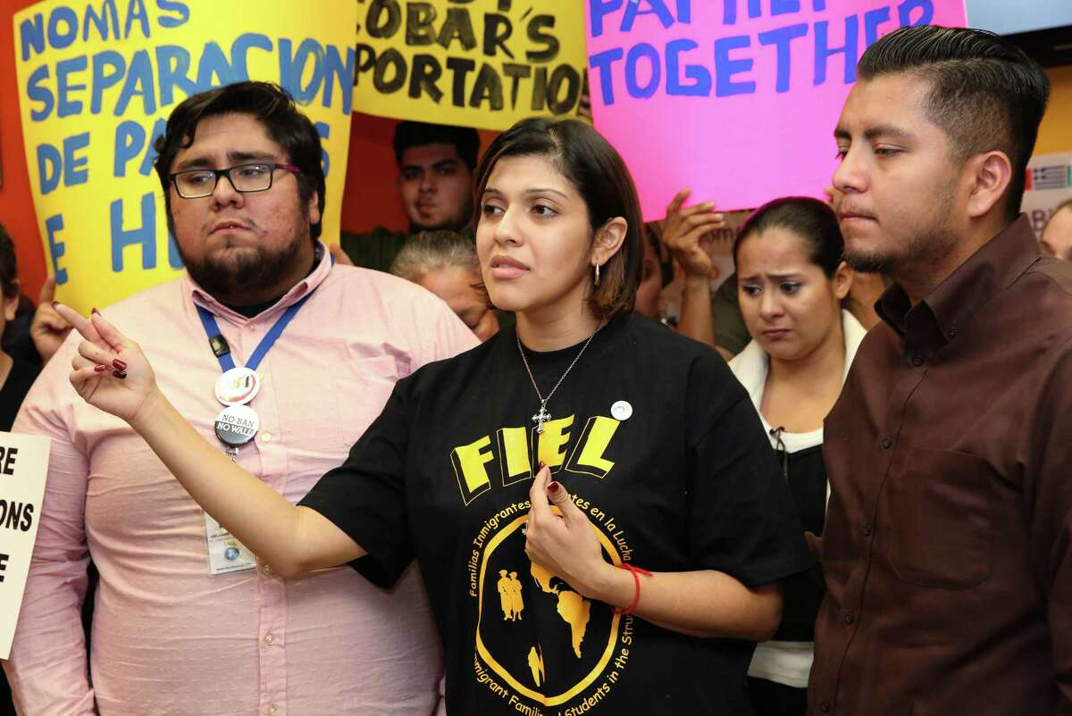 Rose Escobar, accompanied by Familias Immigrantes y Estudiantes en la Lucha (FIEL) representatives Abraham Espinosa, left, and Ceser Espinosa, denounces the Trump Administration for deporting undocumented immigrants who do not have criminal records instead of criminals at a press conference Thursday, March 2, 2017, in Houston. Escobar's husband, Jose Escobar, 31, was deofrted Thursday. Jose Escobar came to the United States from El Slvador without legal status at the age of 15.