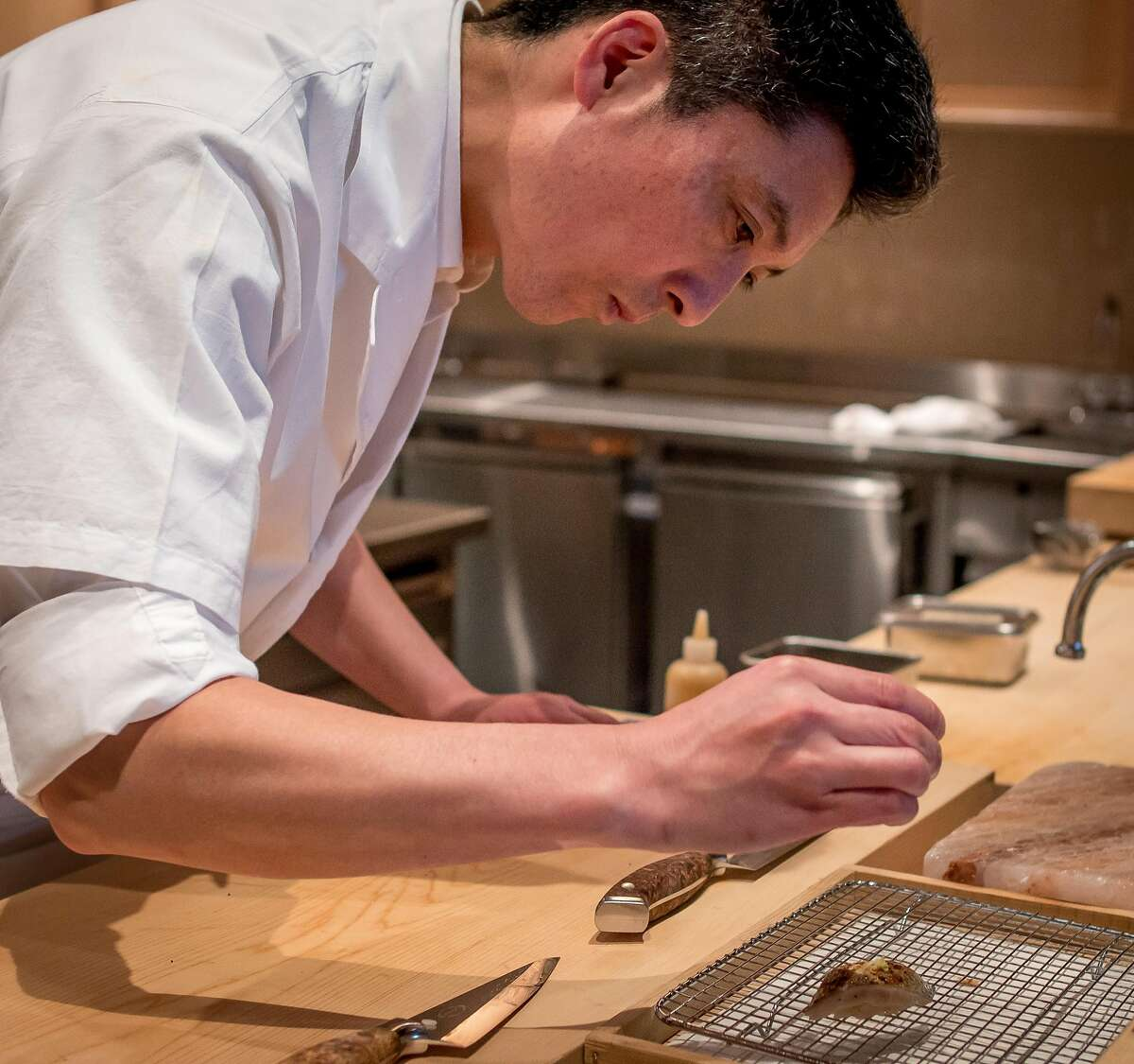 Chef Tokatoshi Toshi prepares sushi at Kinjo in San Francisco, Calif. on March 2nd, 2017.