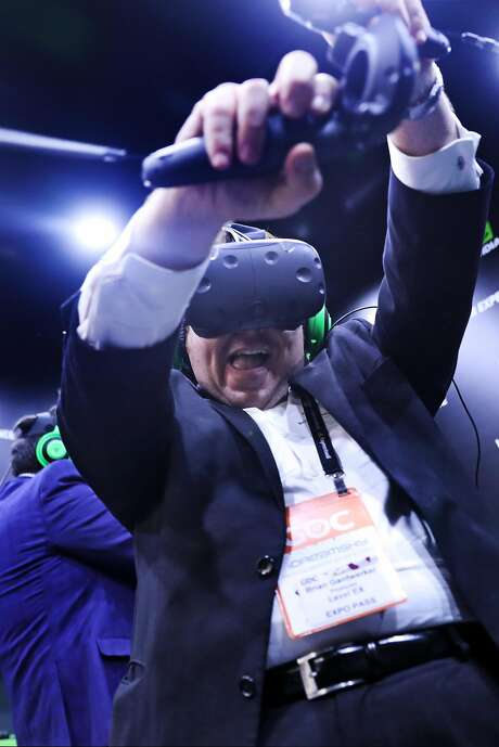 Dr. Brian Gantwerker enjoys a VR demonstration while visiting the Game Developers Conference in San Francisco on March 2, 2017. Photo: Scott Strazzante, The Chronicle