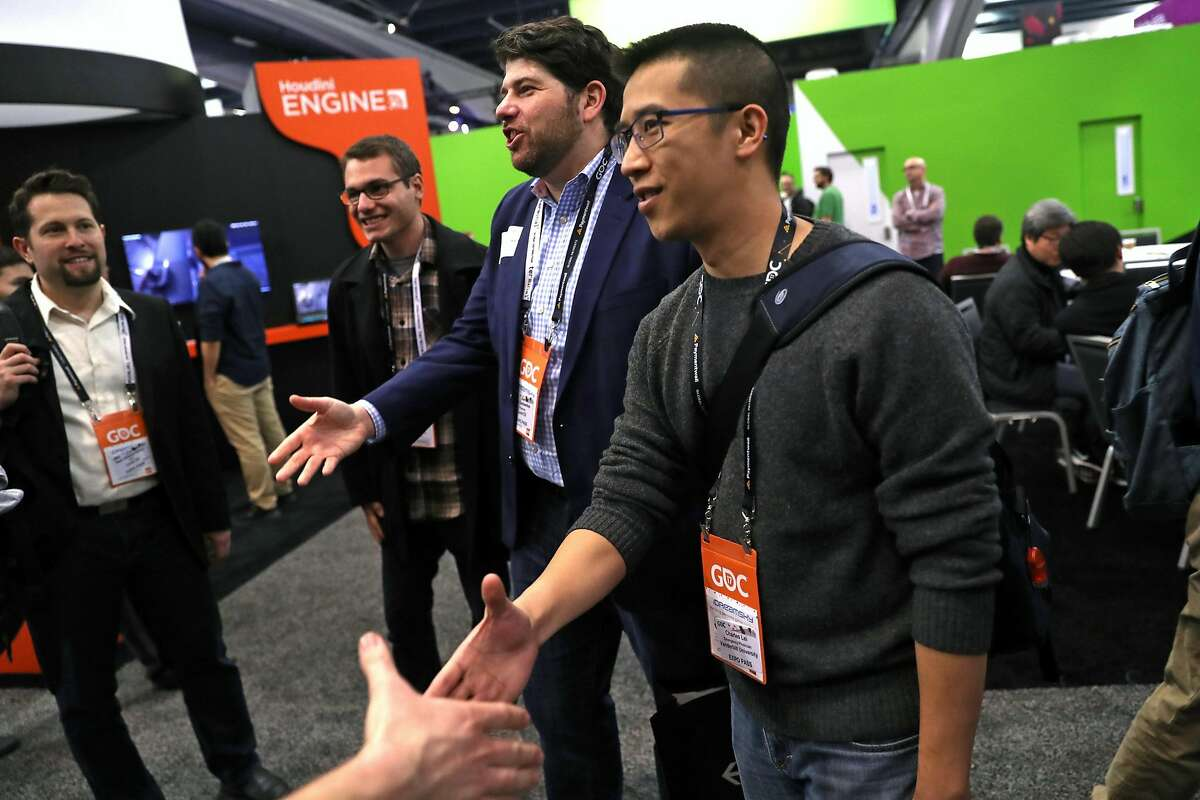 Dr. Charles Lei (right) and Dr. Eric Gantwerker meet game programmers during a visit to the physician's Game Developers Conference in San Francisco, Calif., on Thursday, March 2, 2017.