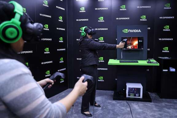 Dr. Komal Bajaj and Dr. Karen Wang (left) test a VR system at the Game Developers Conference in San Francisco, Calif., on Thursday, March 2, 2017.