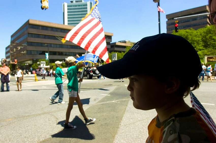 Harrison Mirkin, 3, takes in the performances during Stamford's Memorial Day Parade from Bull's Head to Veteran's Park Sunday May 30, 2010.