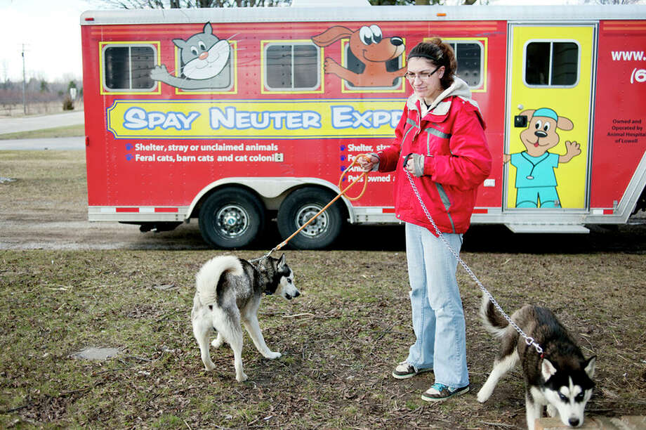 The Spay Neuter Express vehicle can be seen operating in Midland County in this Daily News file photo. Bruce Langlois, who runs the mobile clinic, has been charged with three counts of unauthorized practice of veterinary medicine and habitual offender-third. / Midland Daily News