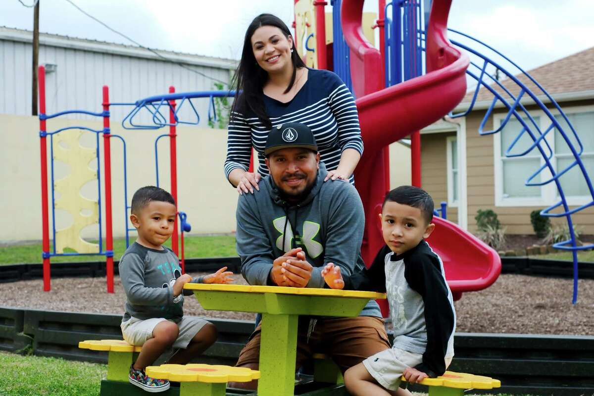 Adrian Hernandez, his wife Jennifer Miranda and their sons Maverick, 2, left, and Project Joy and Hope care recipient Maddox Hernandez, 4, visit the playground near their temporary home at the Tulip Project in Pasadena. Project Joy and Hope offers pediatric care for children with life-threatening illnesses, with families staying on six on-site homes. The nonprofit plans to add a Palliative Care Center to serve the broader needs of anyone needing end-of-life care.