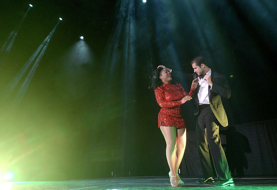 "Jefferson Fisher and Gina Guillory take their spin  onstage to perform during the Junior League of Beaumont's fundraising event ""Dancing with the Stars of Southeast Texas"" Thursday night at the Civic Center. Guests donned their cocktail attire to eat, drink, and enjoy the entertainment of eight celebrity couples performing their dances. Contestants have been working with local dance instructors, honing their skills and perfecting their steps in hopes of taking home the winning trophy. Money raised from the event benefit the community projects in which the junior League is involved. Photo taken Thursday, March 2, 2017 Kim Brent/The Enterprise Photo: Kim Brent / BEN"