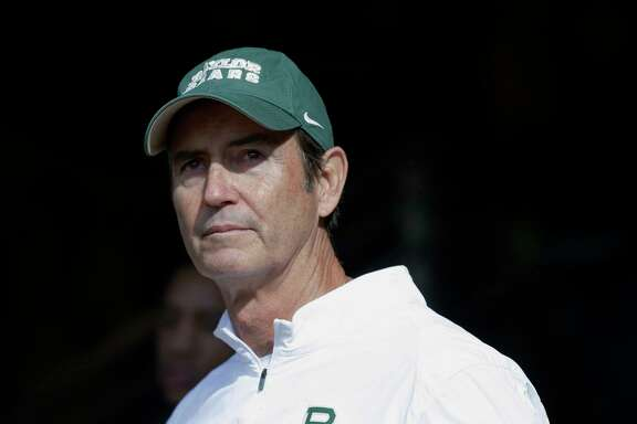FILE - In this Dec. 5, 2015, file photo, Baylor coach Art Briles stands in the tunnel before the team's NCAA college football game against Texas in Waco, Texas. Former Baylor coach Briles conceded months ago that the sexual assault scandal that led to his firing likely ended his career. That's not the case for some of his former assistants, including his son Kendal Briles. (AP Photo/LM Otero, File)