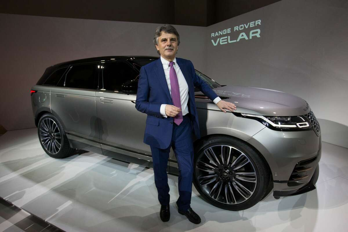 Jaguar Land Rover CEO Ralph Speth poses alongisde the new Range Rover Velar during its unveiling at the London Design Museum in London on March 1, 2017.