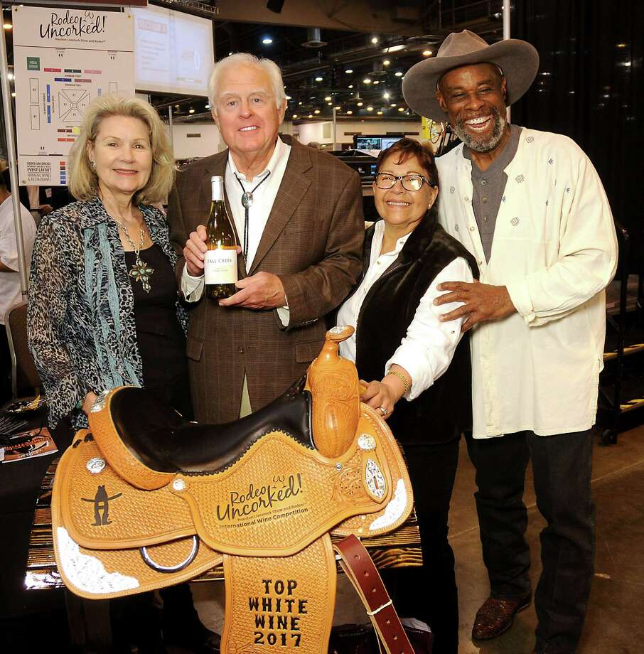 From left: Fall Creek Vineyards owners and 2017 Best White Wine winners Susan and Ed Auler with grape growers Martha Cervantes and Alphonse Dotson at the Rodeo Uncorked and Best Bites Competition at NRG Center Feb. 26. Photo: Dave Rossman, Freelance / Dave Rossman